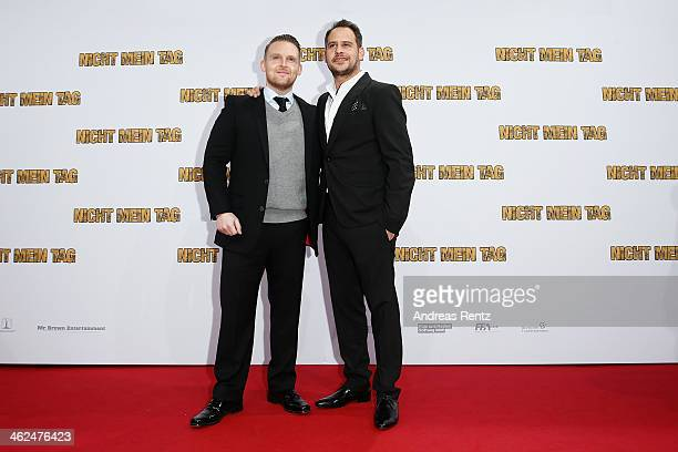 Axel Stein and Moritz Bleibtreu attend the premiere of the film 'Nicht mein Tag' at CineStar on January 13 2014 in Berlin Germany