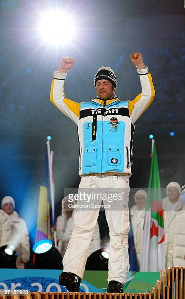 Axel Teichmann of Germany receives the silver medal during the medal ceremony for the men's 50 km mass start crosscountry skiing held during the...