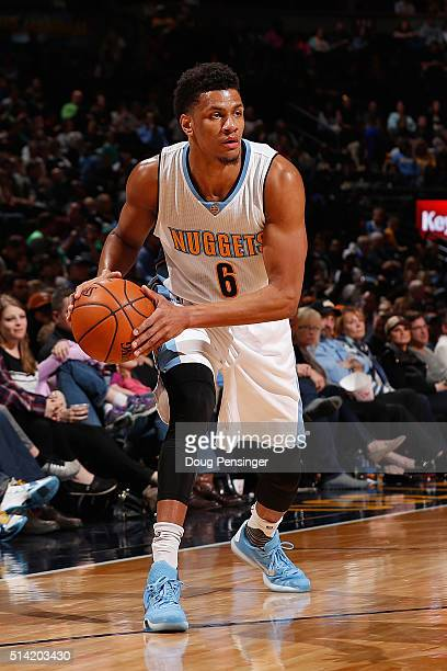 Axel Toupane of the Denver Nuggets controls the ball against the Dallas Mavericks at Pepsi Center on March 6 2016 in Denver Colorado The Nuggets...