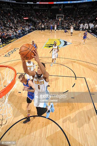 Axel Toupane of the Denver Nuggets goes to the basket against the New York Knicks on March 8 2016 at the Pepsi Center in Denver Colorado NOTE TO USER...
