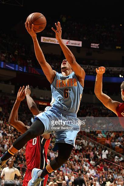 Axel Toupane of the Denver Nuggets shoots the ball against the Miami Heat on March 14 2016 at American Airlines Arena in Miami Florida NOTE TO USER...