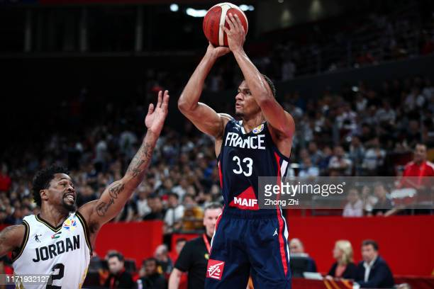 Axel Toupane of the France National Team in action against Dar Tucker of the Jordan National Team during the 1st round of 2019 FIBA World Cup at...