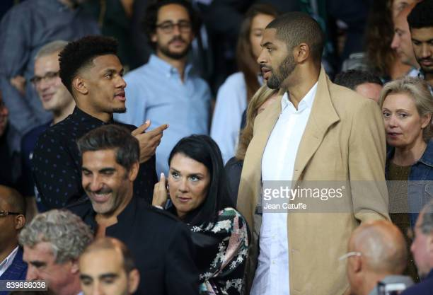 Axel Toupane of Zalgiris Kaunas and Nicolas Batum of Charlotte Hornets attend the French Ligue 1 match between Paris Saint Germain and AS...