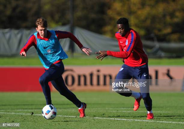 Axel Tuanzebe and Kieran Dowell of England U21's during a training session at St Georges Park on November 8 2017 in BurtonuponTrent England