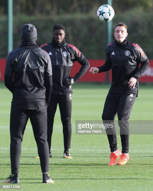 Axel Tuanzebe and Phil Jones of Manchester United in action during a training session at Aon Training Complex on October 30 2017 in Manchester England