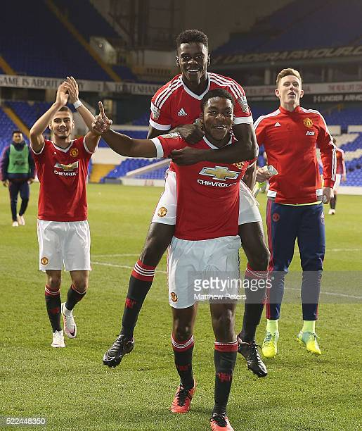 Axel Tuanzebe and RoShaun Williams of Manchester United U21s celebrate winning the U21s League after the Barclays U21 Premier League match between...