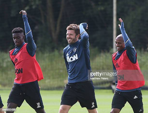 Axel Tuanzebe Michael Carrick and Ashley Young of Manchester United in action during a first team training session at Aon Training Complex on July 13...
