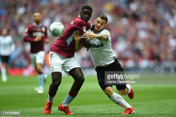 Axel Tuanzebe of Aston Villa battles for possession with Jack Marriott of Derby County during the Sky Bet Championship Play-off Final match between...