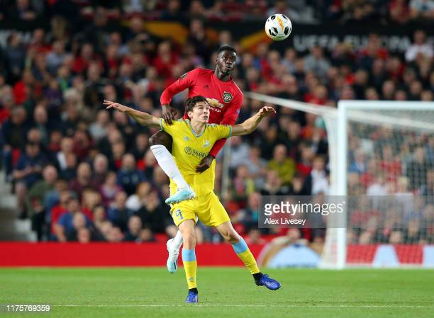 Axel Tuanzebe of Manchester United and Dorin Rotariu of Asanta compete for the ball during the UEFA Europa League group L match between Manchester...