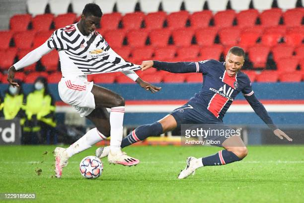 Axel TUANZEBE of Manchester United and Kylian MBAPPE of PSG during the UEFA Champions League match between Paris Saint Germain and Manchester United...