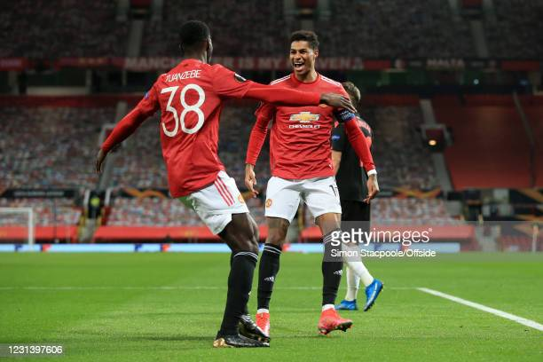 Axel Tuanzebe of Manchester United celebrates with teammate Marcus Rashford of Manchester United after scoring their 1st goal before seeing his goal...