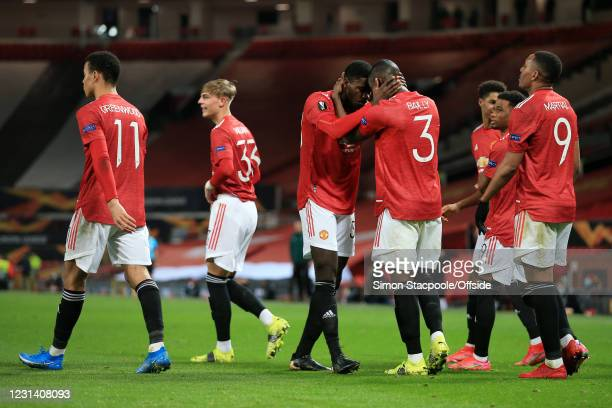 Axel Tuanzebe of Manchester United hugs Eric Bailly of Manchester United after scoring their 1st goal before seeing it ruled out by the Video...