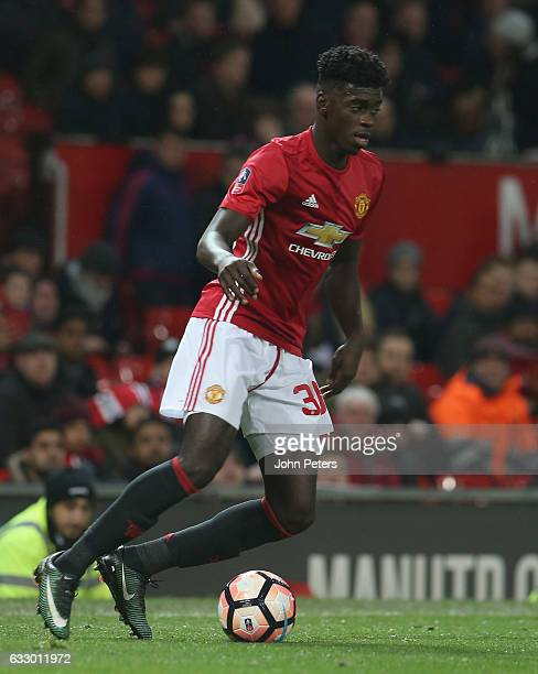 Axel Tuanzebe of Manchester United in action during the Emirates FA Cup Fourth Round match between Manchester United and Wigan Athletic at Old...
