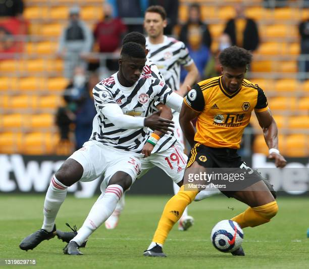 Axel Tuanzebe of Manchester United in action with Adama Traore of Wolverhampton Wanderers during the Premier League match between Wolverhampton...