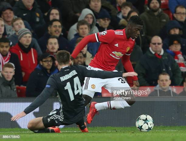 Axel Tuanzebe of Manchester United in action with Kirill Nababkin of CSKA Moscow during the UEFA Champions League group A match between Manchester...