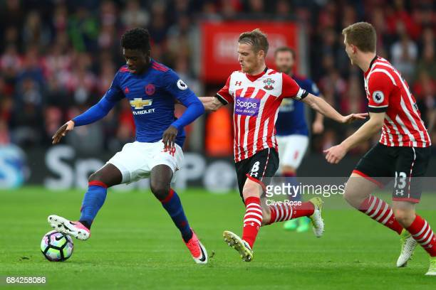 Axel Tuanzebe of Manchester United is put under pressure from Steven Davis of Southampton during the Premier League match between Southampton and...