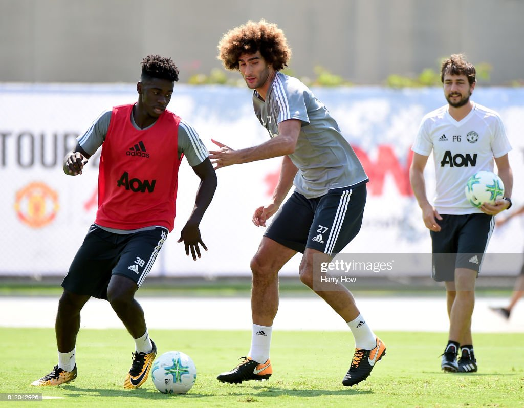 Axel Tuanzebe of Manchester United keeps the ball from Marouane Fellaini #27 during training for Tour 2017 at UCLA's Drake Stadium on July 10, 2017 in Los Angeles, California.