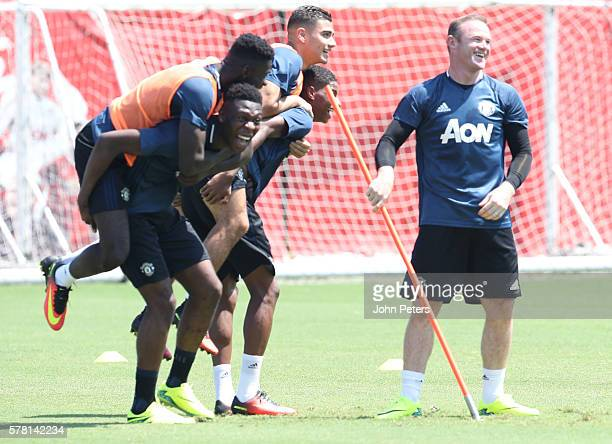 Axel Tuanzebe Timothy FosuMensah Wayne Rooney Marcus Rashford and Andreas Pereira of Manchester United in action during a first team training session...
