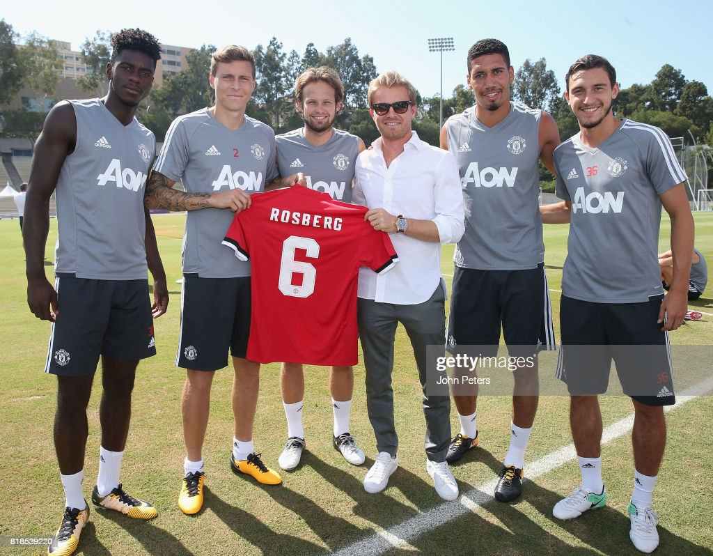 Axel Tuanzebe, Victor Lindelof and Daley Blind, Chris Smalling and Matteo Darmian of Manchester United present Formula One world champion Nico Rosberg with a United shirt ahead of a first team training session as part of their pre-season tour of the USA at UCLA on July 18, 2017 in Los Angeles, California.