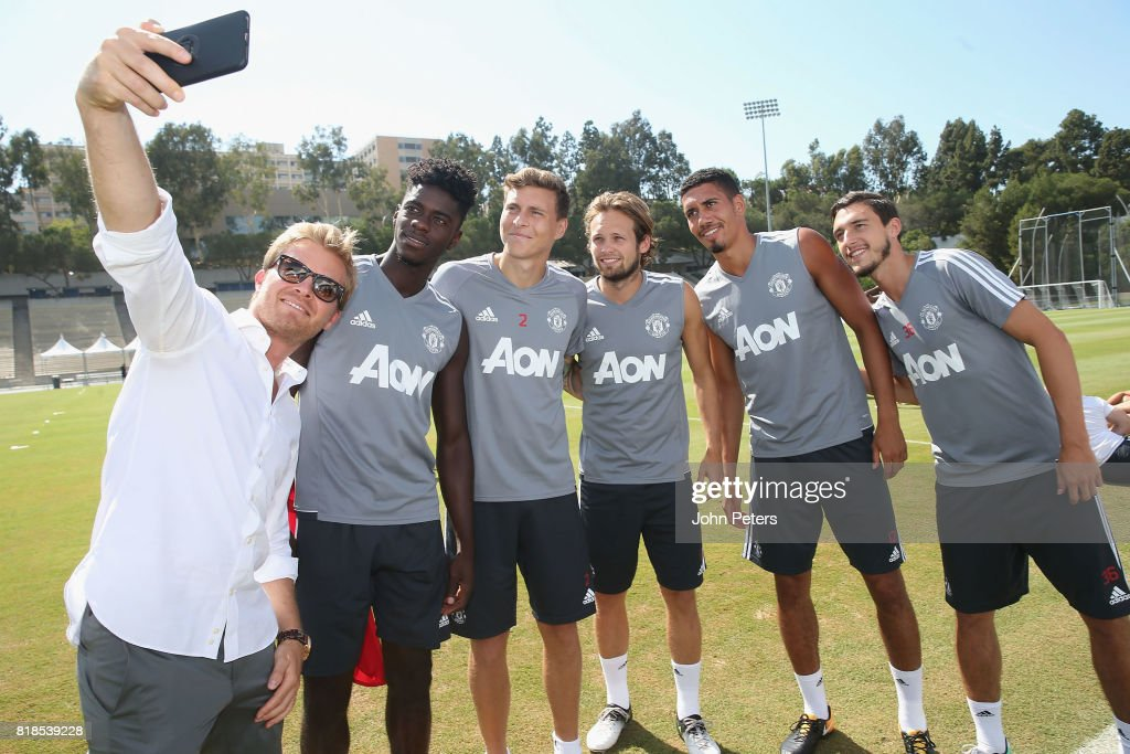 Axel Tuanzebe, Victor Lindelof and Daley Blind, Chris Smalling and Matteo Darmian of Manchester United take a selfie with Formula One world champion Nico Rosberg ahead of a first team training session as part of their pre-season tour of the USA at UCLA on July 18, 2017 in Los Angeles, California.