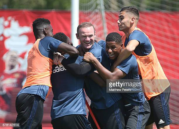 Axel Tuanzebe, Wayne Rooney, Marcus Rashford and Andreas Pereira of Manchester United in action during a first team training session as part of their...