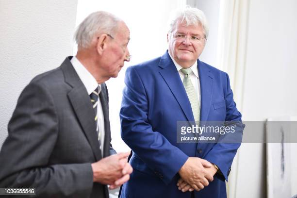 Axel W former manager of Karlsruhe Institut fuer Technologie and his lawyer Ernst Oelkers at the court room of the regional court in Karlsruhe...