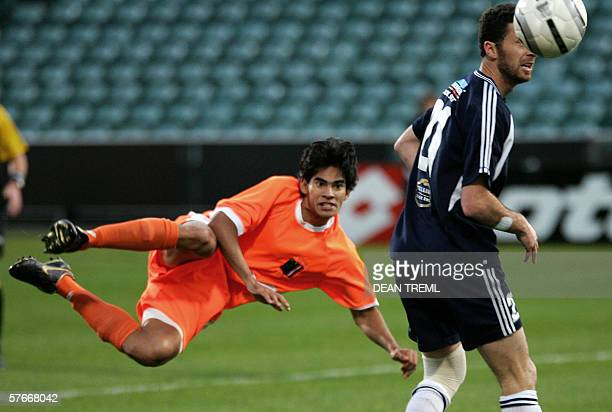 Axel Williams of Tahiti's AS Pirae FC takes a shot past Riki Van Steeden of New Zealand's Auckland City FC during the final of the Oceania Football...
