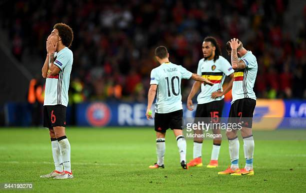 Axel Witsel and Belgium players show their dejection after their 1-3 defeat in the UEFA EURO 2016 quarter final match between Wales and Belgium at...