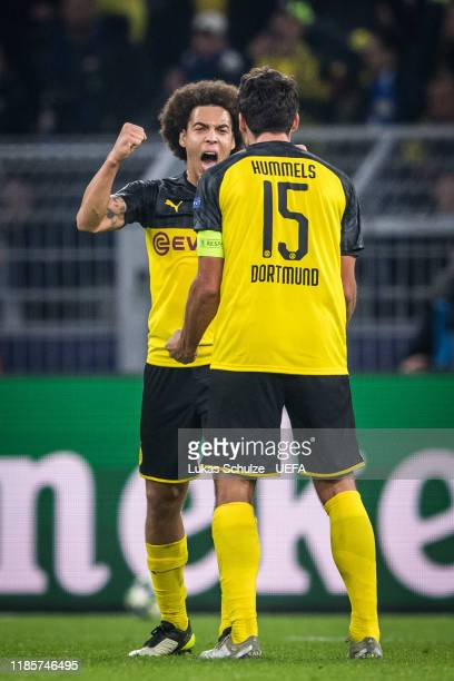 Axel Witsel and Mats Hummels of Dortmund celebrate their win of the UEFA Champions League group F match between Borussia Dortmund and Inter at Signal...