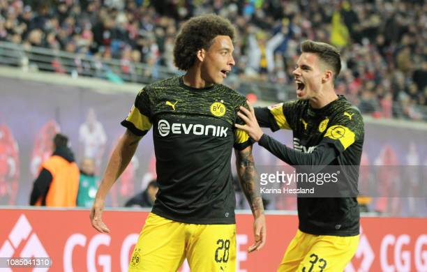 Axel Witsel celebrates the opening goal with Julian Weigl of Dortmund during the first Bundesliga match between RB Leipzig and Borussia Dortmund at...