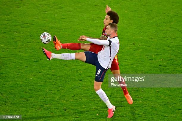 Axel Witsel midfielder of Belgium battles for the ball with Jordan Henderson midfielder of England during the UEFA Nations League match group stage...