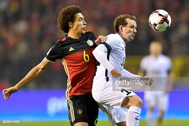 Axel Witsel midfielder of Belgium battles for the ball with Konstantin Vassiljev midfielder of Estonia during the World Cup Qualifier Group H match...