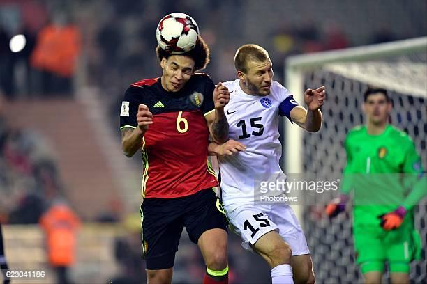 Axel Witsel midfielder of Belgium classes heads with Ragnar Klavan defender of Estonia during the World Cup Qualifier Group H match between Belgium...