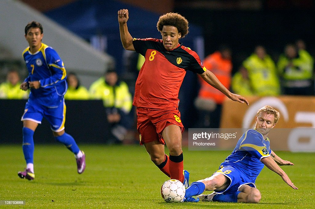 Axel Witsel of Belgium and Andrei Karpovich of Kazakhstan (R) battle for the ball during the UEFA EURO 2012 Group A qualifying match between Belgium and Kazakhstan at King Baudouin Stadium on October 7, 2011 in Brussels, Belgium.