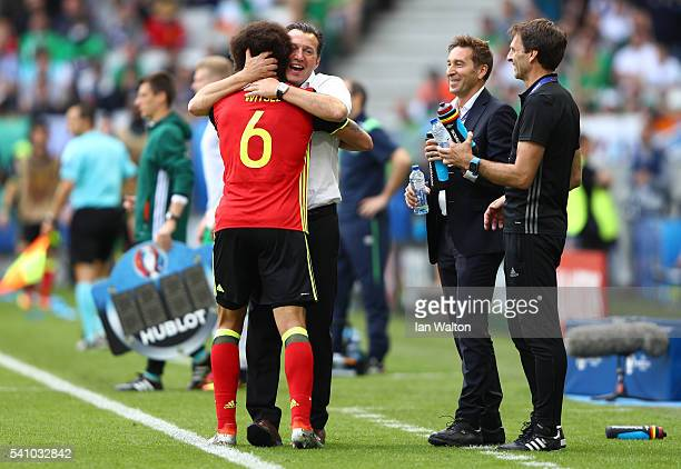 Axel Witsel of Belgium celebrates with Marc Wilmots manager of Belgium after he scores his team's second goal during the UEFA EURO 2016 Group E match...