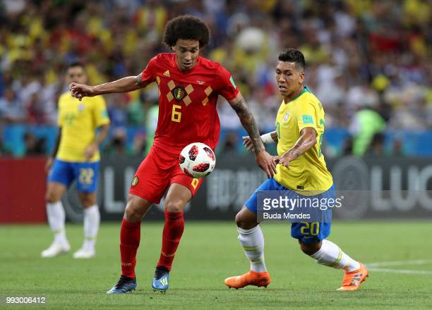 Axel Witsel of Belgium is challenged by Roberto Firmino of Brazil during the 2018 FIFA World Cup Russia Quarter Final match between Brazil and...
