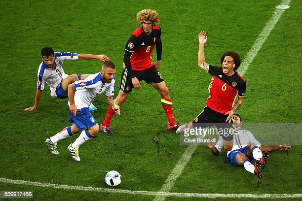 Axel Witsel of Belgium is fouled by Eder of Italy during the UEFA EURO 2016 Group E match between Belgium and Italy at Stade des Lumieres on June 13...