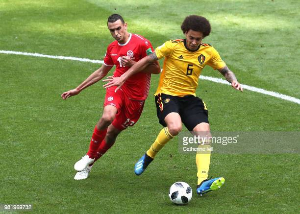 Axel Witsel of Belgium is tackled by Ellyes Skhiri of Tunisia during the 2018 FIFA World Cup Russia group G match between Belgium and Tunisia at...