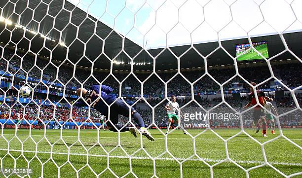 Axel Witsel of Belgium scores his team's second goal past Darren Randolph of Republic of Ireland during the UEFA EURO 2016 Group E match between...