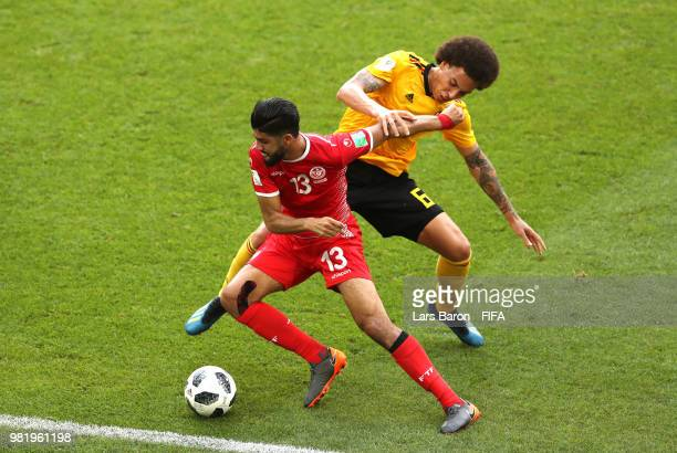 Axel Witsel of Belgium tackles Ferjani Sassi of Tunisia during the 2018 FIFA World Cup Russia group G match between Belgium and Tunisia at Spartak...