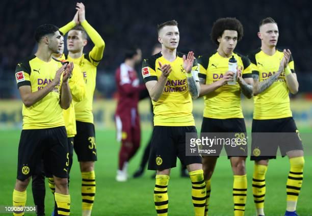 Axel Witsel of Borussia Dortmund Achraf Hakimi of Borussia Dortmund Marius Wolf of Borussia Dortmund and Marco Reus of Borussia Dortmund celebrate...