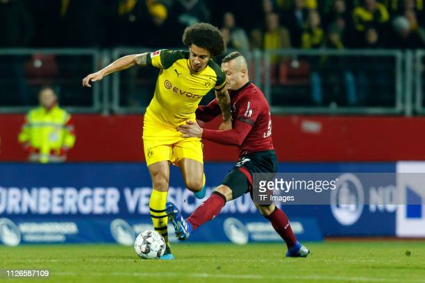 Axel Witsel of Borussia Dortmund and Adam Zrelak of 1 FC Nuernberg battle for the ball during the Bundesliga match between 1 FC Nuernberg and...