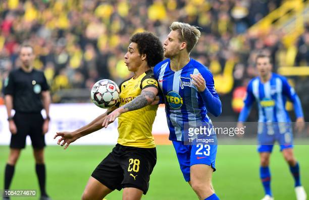 Axel Witsel of Borussia Dortmund and Arne Maier of Hertha BSC battle for the ball during the Bundesliga match between Borussia Dortmund and Hertha...