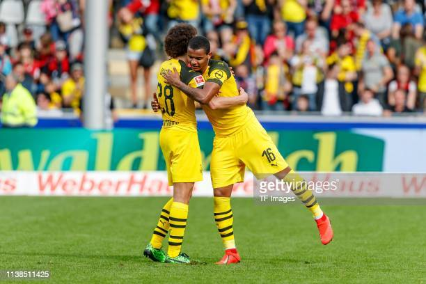 Axel Witsel of Borussia Dortmund and Manuel Akanji of Borussia Dortmund celebrate after winning the Bundesliga match between SportClub Freiburg and...