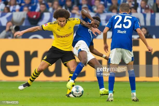 Axel Witsel of Borussia Dortmund and Rabbi Matondo of FC Schalke 04 battle for the ball during the Bundesliga match between FC Schalke 04 and...