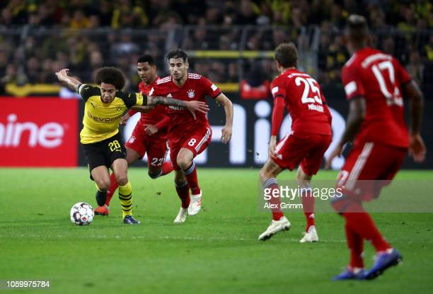 Axel Witsel of Borussia Dortmund battles for possession with Javier Martinez of Bayern Munich during the Bundesliga match between Borussia Dortmund...