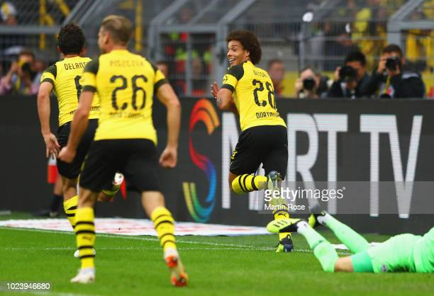 Axel Witsel of Borussia Dortmund celebrates after scoring his team's third goal during the Bundesliga match between Borussia Dortmund and RB Leipzig...