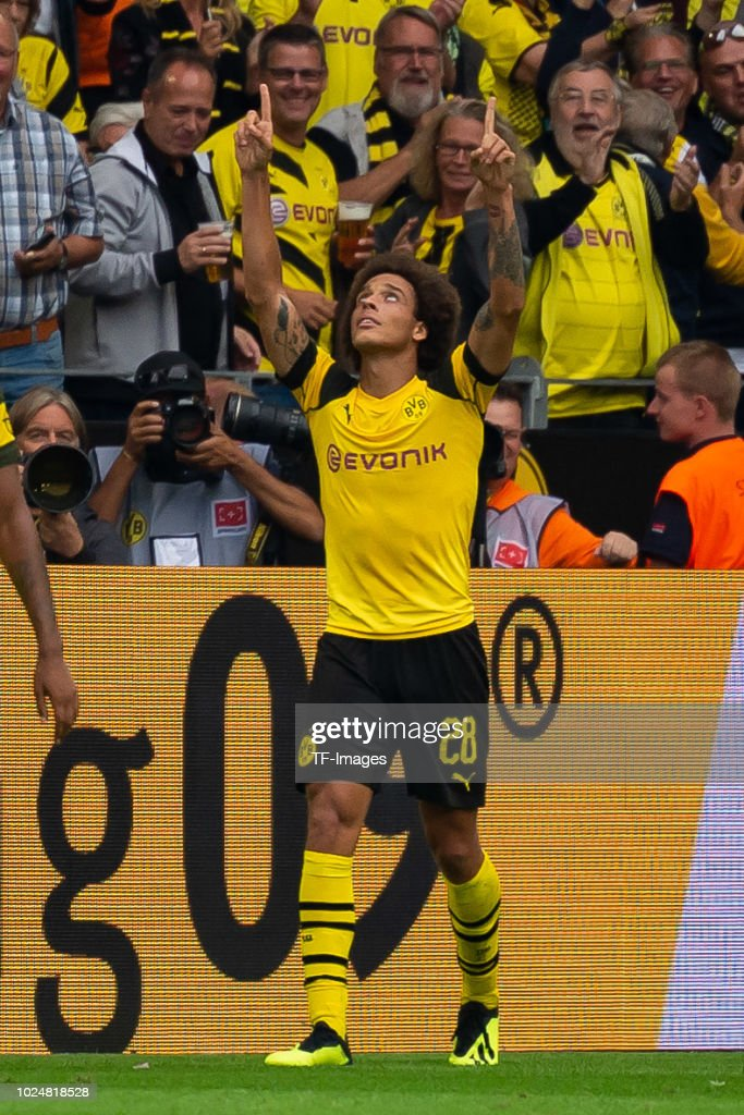 Axel Witsel of Borussia Dortmund celebrates after scoring his team`s third goal with team mates during the Bundesliga match between Borussia Dortmund and RB Leipzig at Signal Iduna Park on August 26, 2018 in Dortmund, Germany.