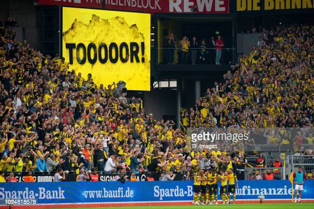 Axel Witsel of Borussia Dortmund celebrates after scoring his team`s third goal with team mates during the Bundesliga match between Borussia Dortmund...
