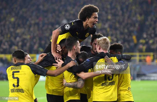 Axel Witsel of Borussia Dortmund celebrates his teams second goal scored by Julian Brandt with his teammates during the UEFA Champions League group F...